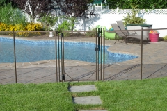 fence-gate-with-green-grass