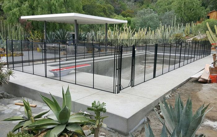 black fence in concrete